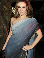 LONDON, ENGLAND - FEBRUARY 23:  (EMBARGOED FOR PUBLICATION IN UK TABLOID NEWSPAPERS UNTIL 48 HOURS AFTER CREATE DATE AND TIME. MANDATORY CREDIT PHOTO BY DAVE M. BENETT/GETTY IMAGES REQUIRED)  Elizabeth Hurley attends the Love Ball London, at the Roundhouse on February 23, 2010 in London, England.  (Photo by Dave M. Benett/Getty Images) *** Local Caption *** Elizabeth Hurley