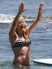 #3176472 Tea Leoni shows off a rocking bikini body as she splashes around the waves in Malibu, CA on June 21, 2009.
