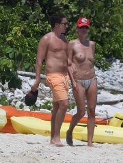116726, CONTAINS NUDITY: Heidi Klum spends a PDA-filled day on the beach with boyfriend Vito Schnabel in Mexico. The model was lathered up with suntan lotion before taking a topless dip in the ocean with her 27 year-old beau. The couple, who have been dating since February, were not shy about showing their affection, as they kissed and stayed close to each other. Mexico - Tuesday April 15, 2014. AUSTRALIA, NEW ZEALAND, INDONESIA, PHILLIPPINES, TAIWAN & HONG KONG OUT. Photograph: © PacificCoastNews. Los Angeles Office: +1 310.822.0419 London Office: +44 208.090.4079 sales@pacificcoastnews.com FEE MUST BE AGREED PRIOR TO USAGE