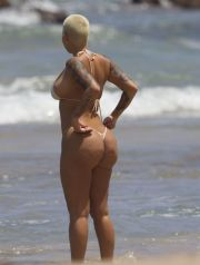 EXCLUSIVE: Amber Rose spotted in Hawaii in a flesh tone bikini on March 25, 2015. She spent the morning on the beach with unknown male friend.
