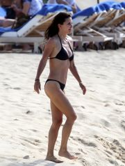 A clearly happy and carefree Courteney Cox enjoys another day on the beach with her Cougar Town co-star  Josh Hopkins. Looking stunning in a skimpy black bikini, Cox was never far away from Hopkins as they splashed in the St Barts waves. Cox is with Coco, six, her daughter with estranged husband David Arquette. Last month, Cox, 46, and Hopkins, 40, were spotted holding hands after the cameras stopped rolling on set. Reps for Cox have insisted she and Hopkins are not a couple and are simply 'friends.'