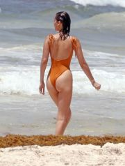 EXCLUSIVE: Bella Hadid displays her supermodel body and long legs as she has some fun in the sea in an orange swimsuit while on holiday in Cancun, Mexico.  The 21 year old was in Mexico for a Vogue photo shoot. The gorgeous brunette shared a photo of herself getting pampered at the luxurious Hotel Esencia before the shoot.