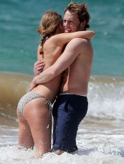 51392220 'The Quiet Ones' actor Sam Claflin and his wife Laura Haddock enjoying a day on the beach in Maui, Hawaii on April 23, 2014. The pair played in the waves and showed some PDA while out on the beach. FameFlynet, Inc - Beverly Hills, CA, USA - +1 (818) 307-4813