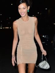 New York, NY  - Bella Hadid is seen after the Victoria's Secret Fashion Show After Party in New York. The supermodel shows off her body as she goes braless in a sheer nude colored dress.