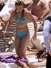 Kristen Bell hits the beach in a smoking hot aqua blue bikini as Dax Shepard hangs on for life during some beach time fun in Hawaii.