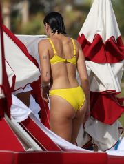 EXCLUSIVE: Singer Dua Lipa wears a yellow bikini as she takes a dip in the ocean with her sister in Miami, then greets her boyfriend on the sand.
