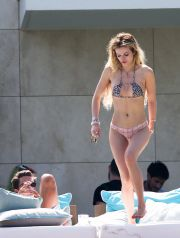 Scott Disick is seen with girlfriend Bella Thorne as they sunbathe at a luxury villa in Cannes, Scott could resist squeezing Bell's Breast a the couple were seen all over each other in the sunshine.