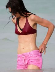 KATIE HOLMES in Bikini Top on the Beach in Miami